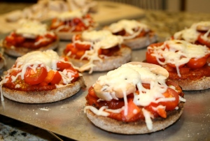 Place under broiler in oven or toaster oven until cheese is melted and toppings are warmed.