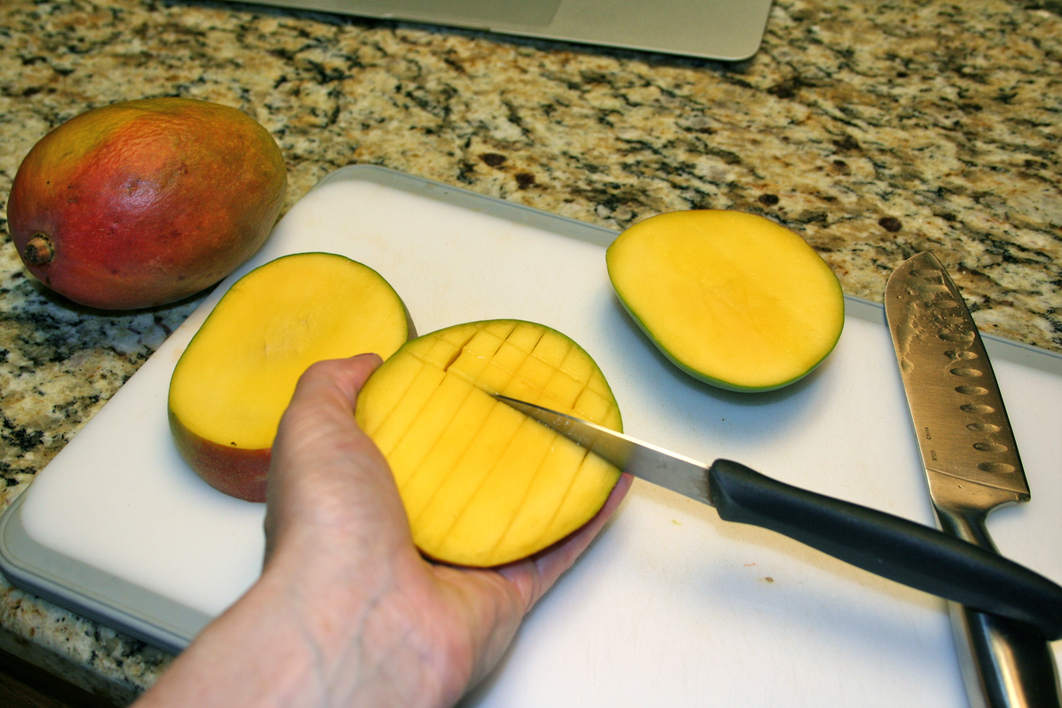 Cut Your Mango By First Slicing Off One Side And Then The Other As Close To