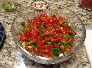 Then add salsa, sour cream, green onions, red peppers.