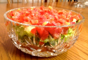 Then add lettuce and tomatoes. Serve with nacho chips!