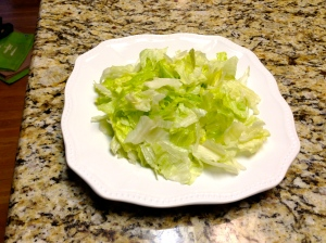 Break lettuce up into bite-sized pieces and place in taco bowl or on plate.