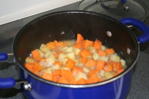 Add the potatoes and cook on medium heat until potatoes are tender--approx 20 minutes.
