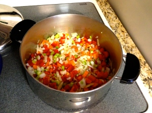 In a separate pot cook the onions, garlic, celery, carrots, peppers over medium heat until they are softened.
