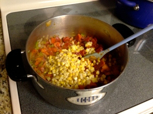 Add tomatoes, tomato paste,  corn, water, chili powder, cumin, oregano and red cayenne pepper.Mix together and bring to a boil.