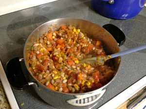 Drain and rinse the beans, and add them to the vegetables.